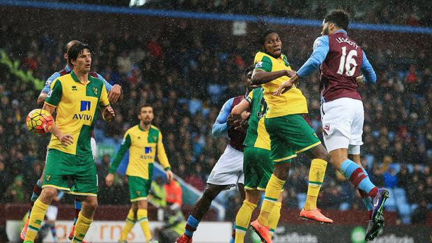 Joleon Lescott scores Aston Villa's first goal in their 2-0 win over Norwich