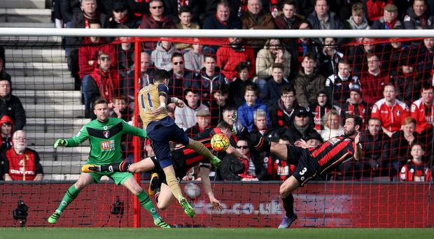 Arsenal's Mesut Ozil scores his side's first goal of the game against Bournemouth.