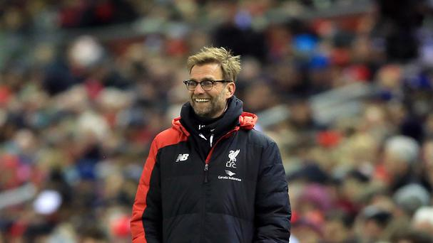 Liverpool manager Jurgen Klopp returned from an appendix operation to offer hope to fans protesting over rising ticket prices.