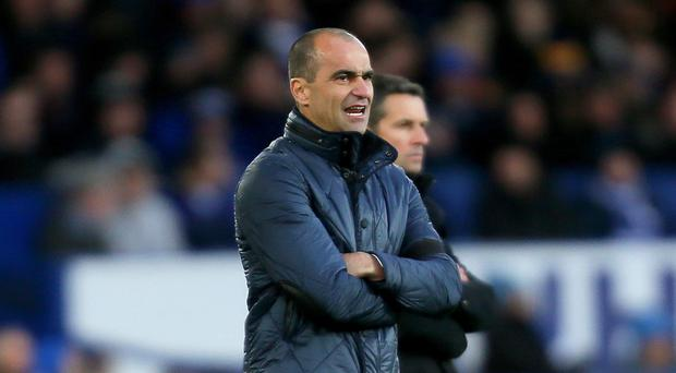 Everton manager Roberto Martinez has praised a nine-year-old fan with cerebral palsy for his inspiration to others