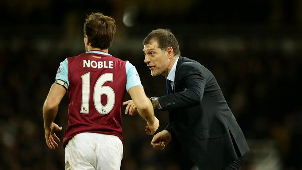 Slaven Bilic, pictured right, believes Mark Noble, left, deserves England recognition