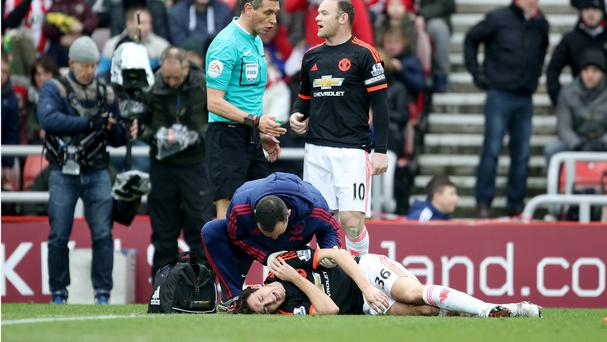 Matteo Darmian receives treatment for a dislocated shoulder