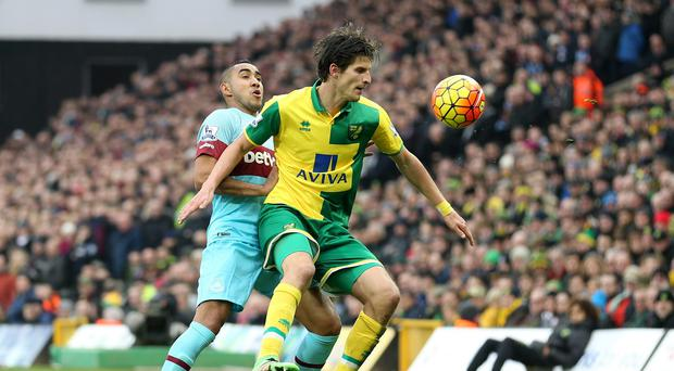 Dimitri Payet, left, helped West Ham come from 2-0 down to draw at Norwich