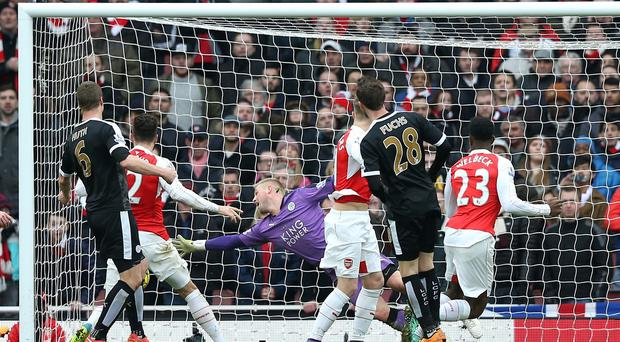 Arsenal's Danny Welbeck (number 23) looks on as his late header beats Leicester goalkeeper Kasper Schmeichel