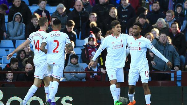 Liverpool's Daniel Sturridge (right) celebrates with team-mate Roberto Firmino after opening the scoring in their 6-0 win at Aston Villa.
