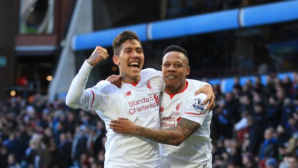 Liverpool's Nathaniel Clyne (right) celebrates with Roberto Firmino after scoring their fifth in a 6-0 win at Aston Villa.