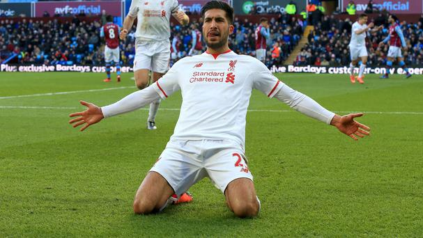 Emre Can celebrates Liverpool's third goal in their 6-0 win at Aston Villa on Sunday