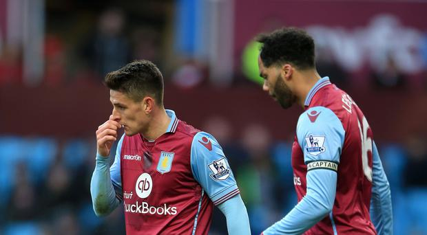 A dejected Ashley Westwood (left) and Joleon Lescott during Aston Villa's 6-0 defeat to Liverpool on Sunday.