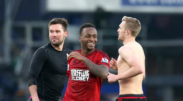 Saido Berahino (centre) celebrates with Ben Foster (left) and Darren Fletcher (right) after West Brom's 1-0 win at Everton.