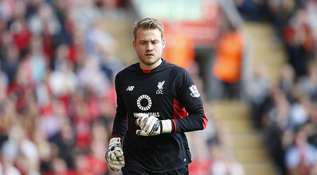Liverpool goalkeeper Simon Mignolet is confident they can cope with two huge games inside four days.