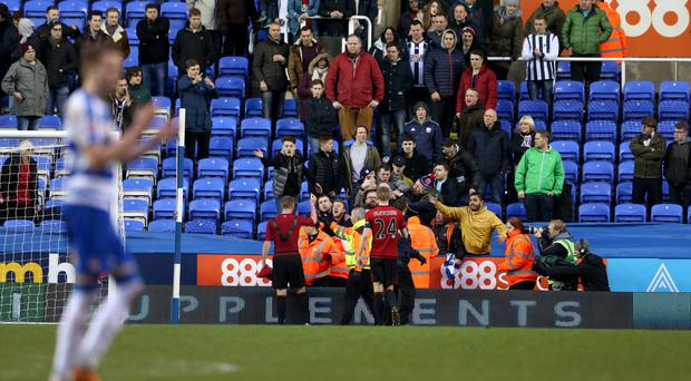 West Brom's Chris Brunt (left) remonstrates with fans after the final whistle of their 3-1 FA Cup defeat to Reading.