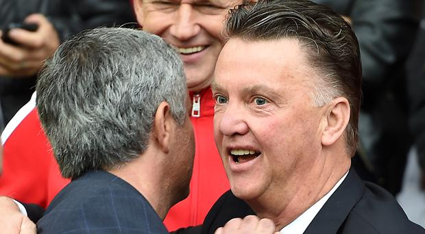 Louis van Gaal (right) is annoyed by talk Jose Mourinho will replace him at Manchester United