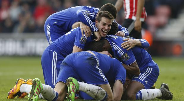 Chelsea players celebrate after Chelsea's Branislav Ivanovic (hidden) scores his sides second goal of the game during the Barclays Premier League match at the St Mary's Stadium, Southampton.
