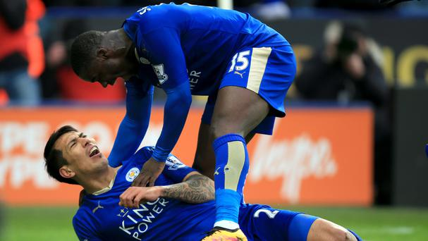Leonardo Ulloa celebrates his winner with Jeff Schlupp, top