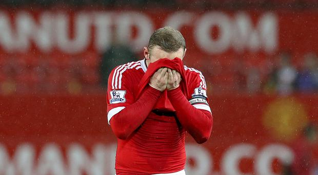 Manchester United manager Louis van Gaal has confirmed captain Wayne Rooney, pictured, would miss out on England's friendly double-header next month.