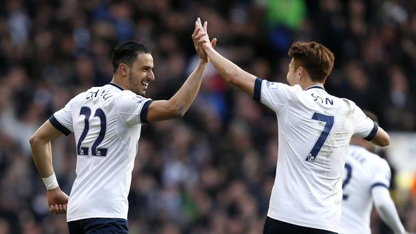 Tottenham's Nacer Chadli, left, celebrates scoring his side's first goal