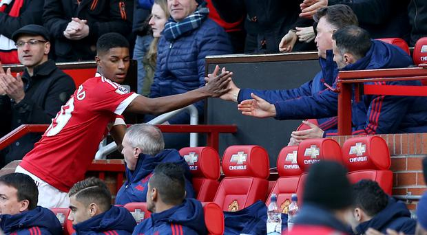 Marcus Rashford, left, is congratulated by Louis van Gaal