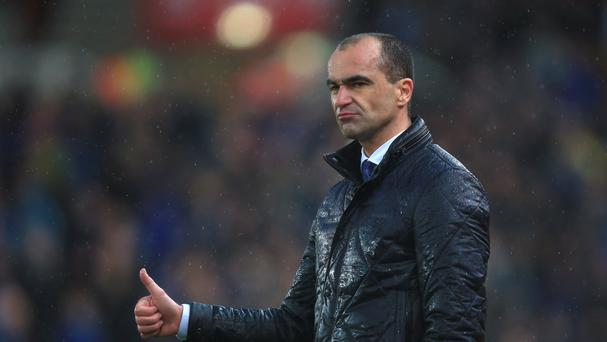 Everton manager Roberto Martinez welcomes the pressure an new billionaire investor to the club will place on him.