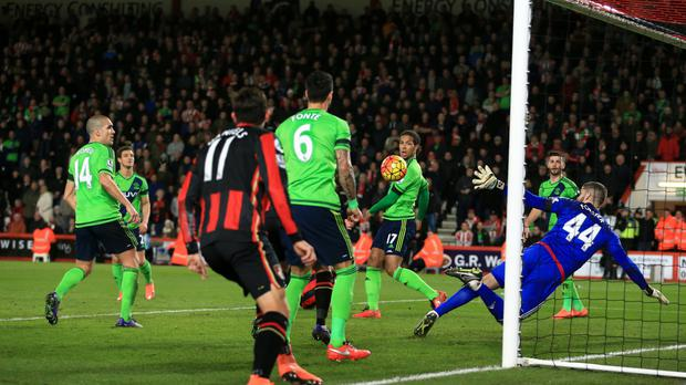 Steve Cook, obscured, scores Bournemouth's opener