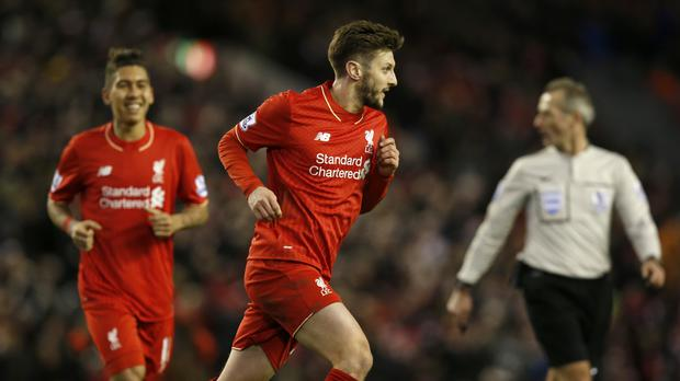 Liverpool's Adam Lallana celebrates his side's first goal of the game