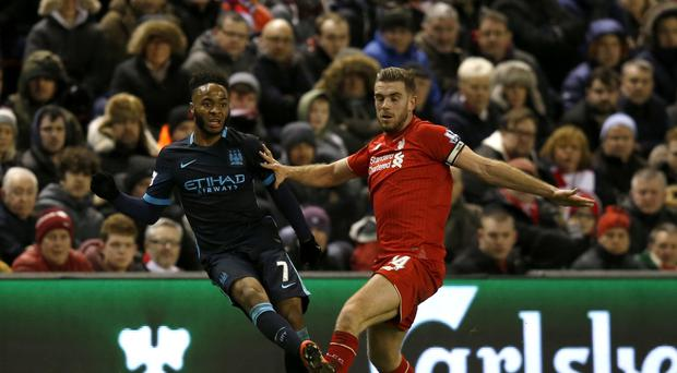 Manchester City's Raheem Sterling (left) had a quiet night on his return to Liverpool