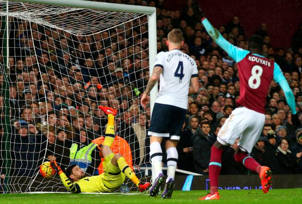 Net gains: Cheikhou Kouyate celebrates as Michail Antonio's shot gets the better of Spurs keeper Hugo Lloris