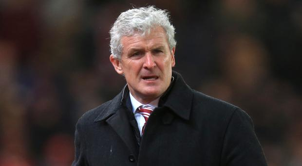 Mark Hughes is hoping to lead Stoke to victory at Chelsea this weekend