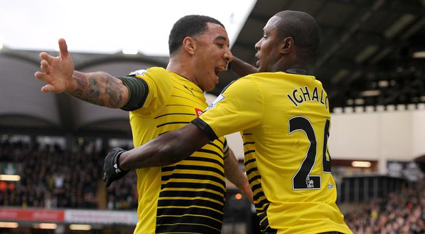 Quique Sanchez Flores expects Troy Deeney (left) and Odion Ighalo to rediscover their goalscoring touch