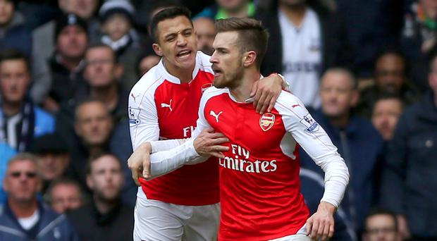 Aaron Ramsey, right, celebrates his opener with Alexis Sanchez, who later scored Arsenal's second