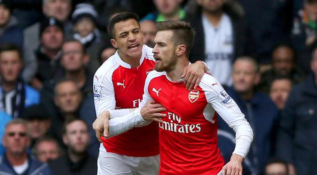 Aaron Ramsey (right) and Alexis Sanchez were on target as 10-man Arsenal battled to a 2-2 draw at Tottenham