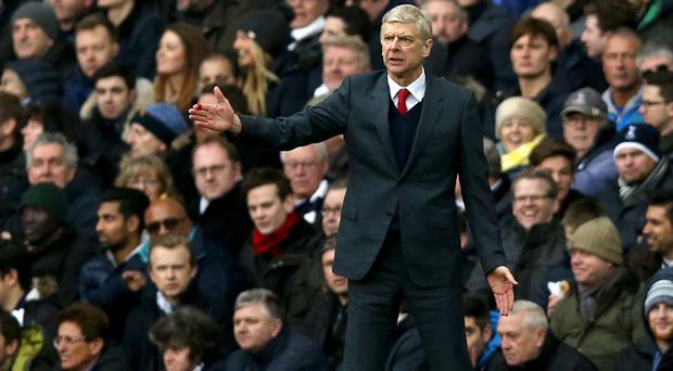 Arsene Wenger saw his 10 men rescue a point at Tottenham