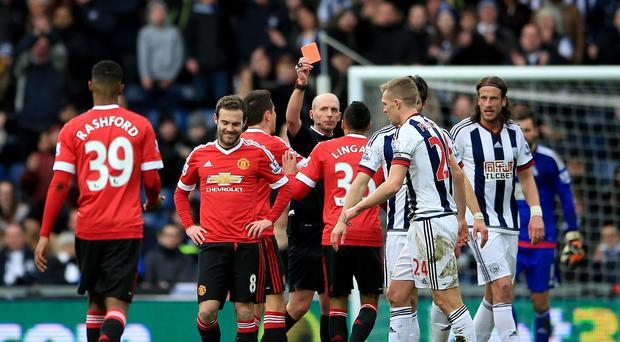 Juan Mata (number eight) receives his red card - the first of his career - in Manchester United's 1-0 defeat at West Brom on Sunday
