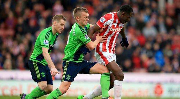 James Ward-Prowse's, centre, Southampton, boosted their chances of returning to European competition at Stoke