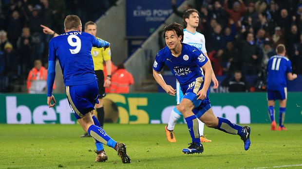 Shinji Okazaki (right) celebrates scoring Leicester's winner