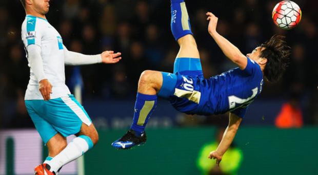 Head over heels: Shinji Okazaki acrobatically fires home Leicester's winner against Newcastle