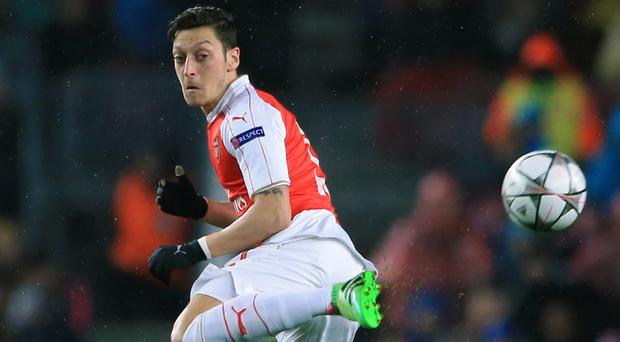 Mesut Ozil believes Arsenal can still win the league this season.