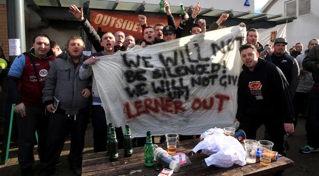 A group of Aston Villa fans has called for owner Randy Lerner to leave the club