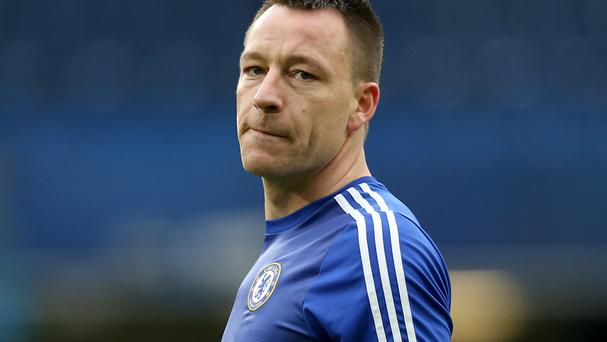 Chelsea interim boss Guus Hiddink has advised John Terry(pictured) to play on for as long as possible if he wishes to be a manager