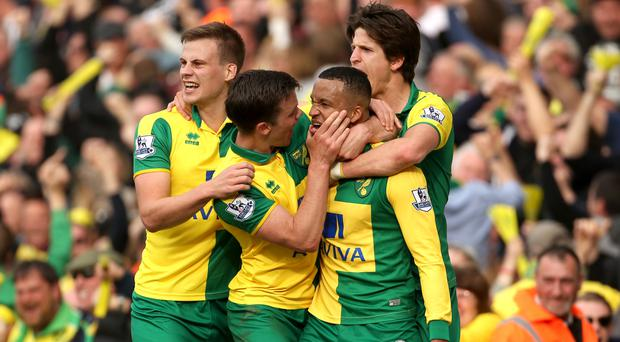 Martin Olsson (second right) celebrates scoring the winning goal with his Norwich team-mates