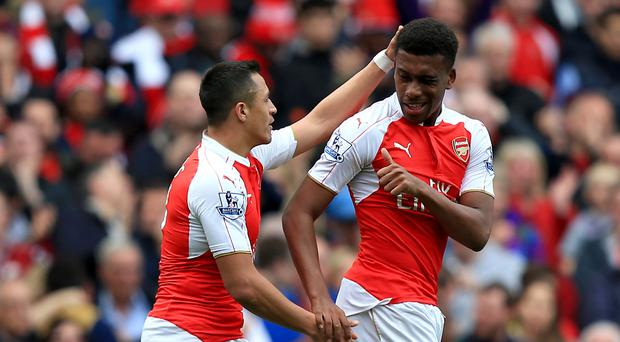 Alex Iwobi, right, celebrates with team-mate Alexis Sanchez after scoring Arsenal's second goal against Watford