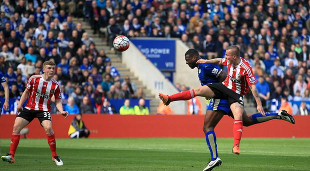 Wes Morgan beats Jordy Clasie to the ball to head in Leicester's winner in their 1-0 victory over Southampton.