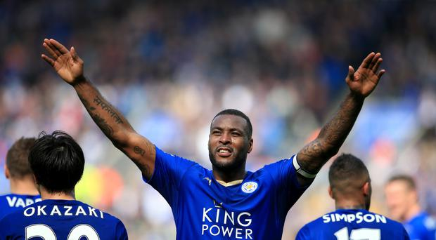 Wes Morgan salutes the Leicester fans after his winner in Sunday's 1-0 victory over Southampton.