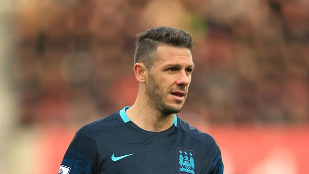 Manchester City's Martin Demichelis is not contesting an FA charge over betting irregularities