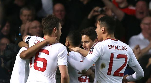 Manchester United's Marcus Rashford (left, obscured) celebrates scoring their first goal