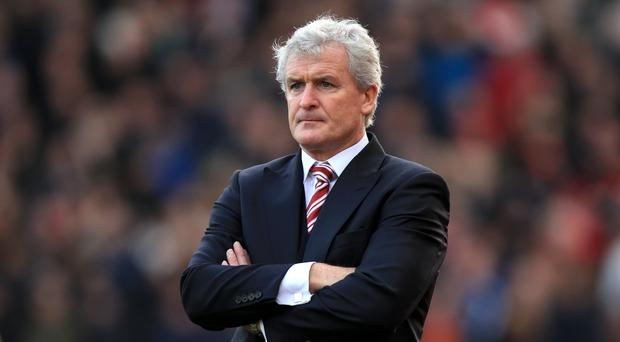 Mark Hughes' Stoke host second-placed Tottenham on Monday.