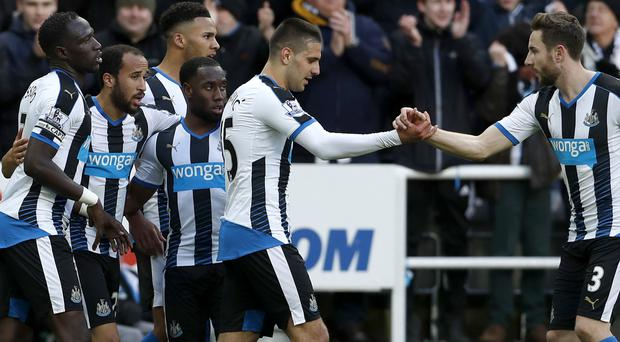 Andros Townsend, second left, scored in Newcastle's win