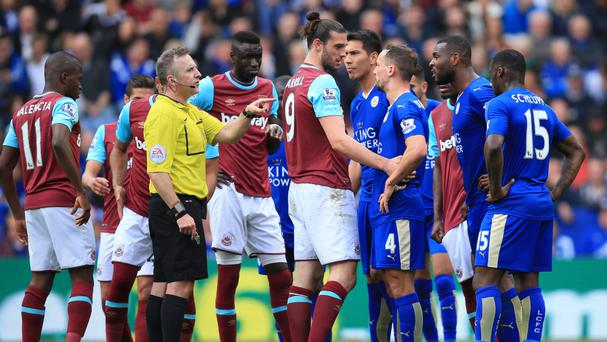 West Ham's Andy Carroll (centre) was furious with referee Jonathan Moss' display against Leicester