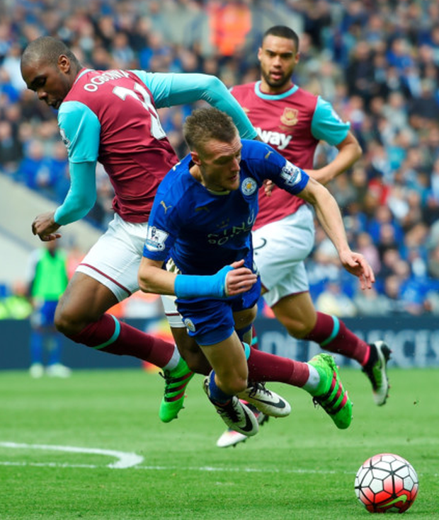 Going over: Leicester ace Jamie Vardy was given a second yellow card for this dive against West Ham