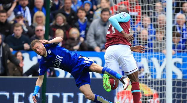 Leicester's Jamie Vardy goes down under a challenge with Angelo Ogbonna and received a second yellow card for diving in the Foxes' 2-2 draw with West Ham.