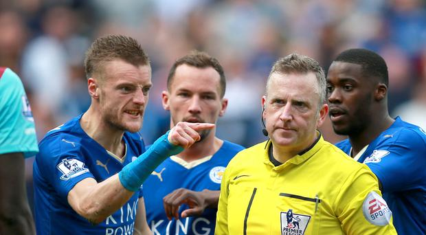 Leicester's Jamie Vardy shows his anger after he is shown a second yellow card for diving by referee Jonathan Moss.